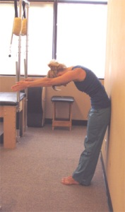 Roll up by lifting each bone away from the next as it presses into  the wall. Create space between vertebre.